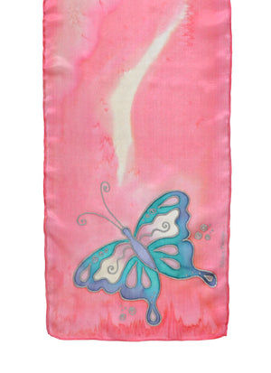 Silk scarf with butterfly design shown in carnation pink