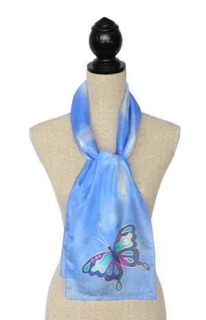 Silk scarf with butterfly design shown on mannequin