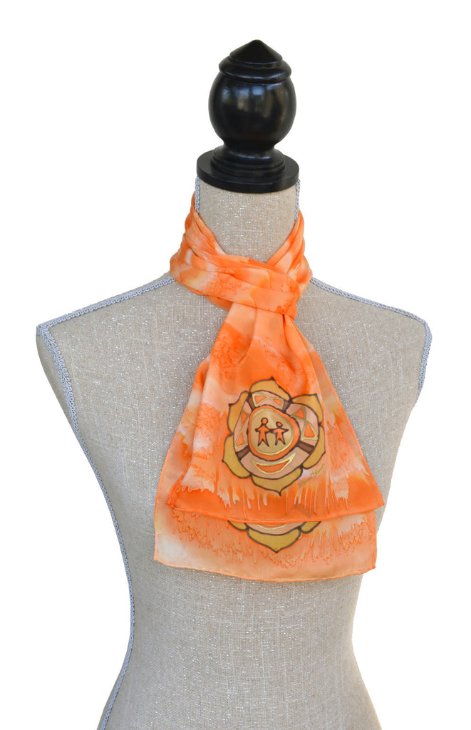 8x54 orange colour energy scarf shown on mannequin
