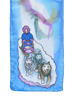 Silk scarf with dog sled design in serenity blue
