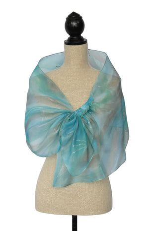 Shawl shown in blues/green with white and beige