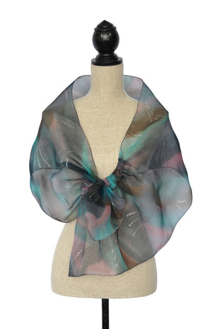 Shawl shown in purple/grey, blue/green, pink, and brown