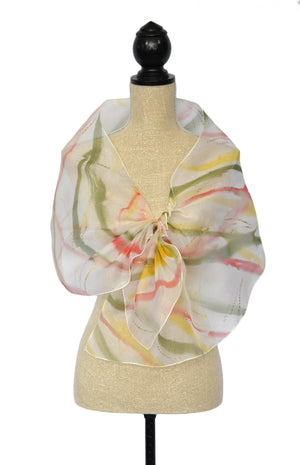 Shawl shown in ivory, green, red, and gold tones
