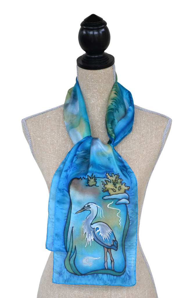 Hand-painted silk blue heron scarf on mannequin
