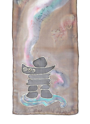 Silk scarf with inuksuk design shown in taupe