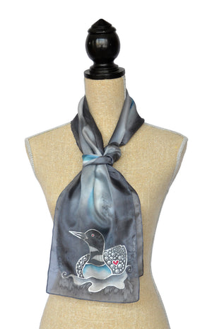Hand-Painted silk scarf with Canadian loon design in medium grey on mannequin