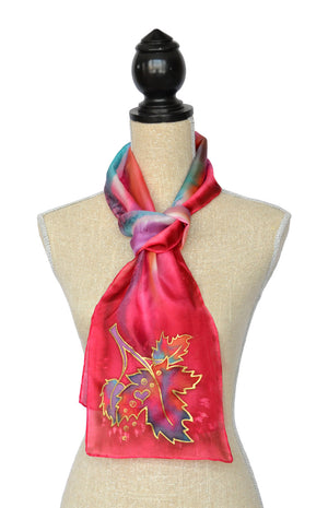 Canadian maple leaf hand-painted silk scarf in rich red shown on mannequin