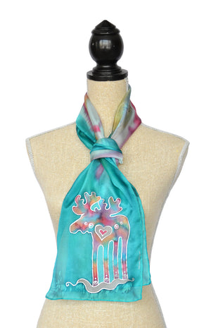 Hand-painted silk scarf with Canadian moose design in lagoon blue - shown on mannequin
