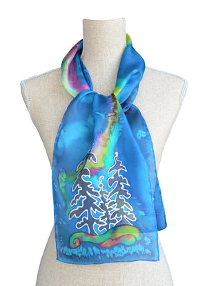 Hand-painted silk scarf blue northern lights on mannequin