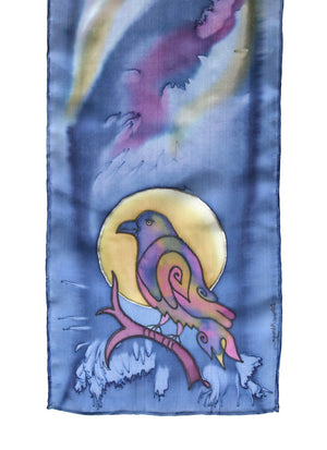 Silk scarf with raven design shown in lavender