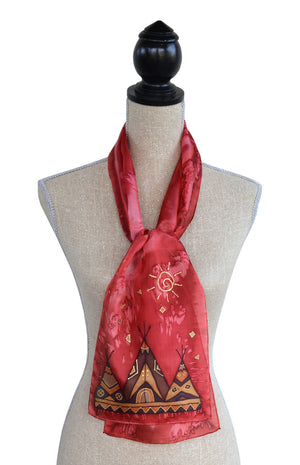 Hand-painted silk tipi scarf in red shown on mannequin