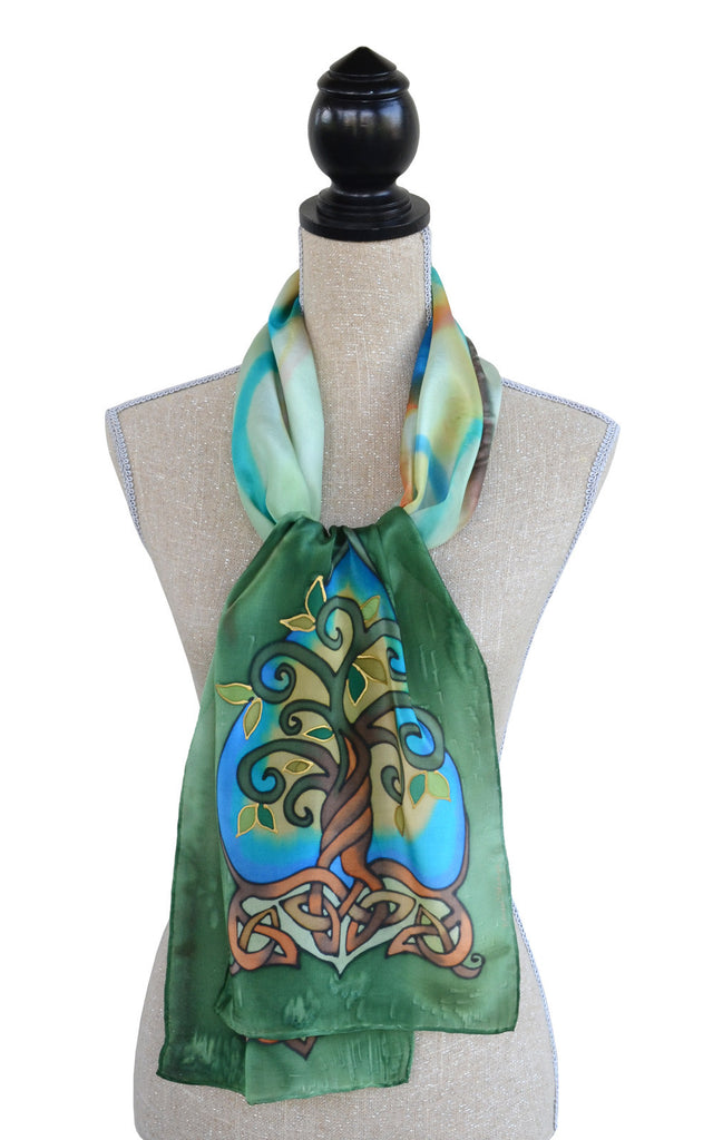 Hand-painted silk tree of life scarf shown on mannequin