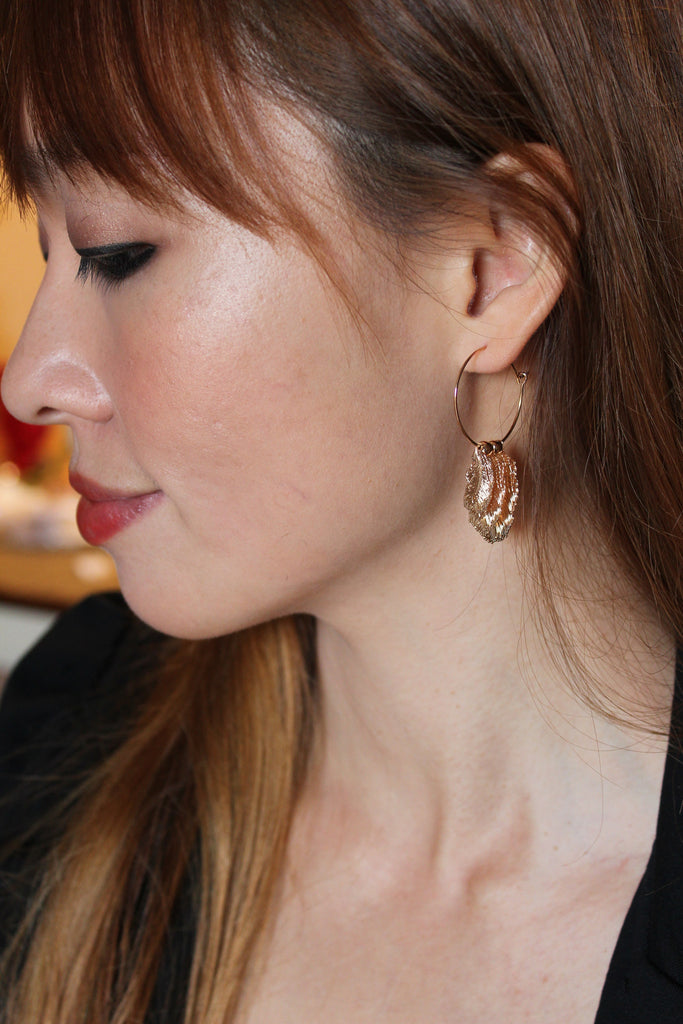 Fashion feather gold earrings