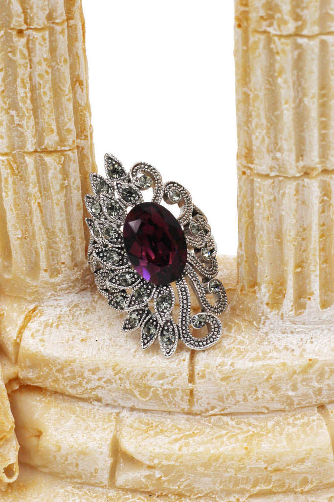 elegant asymmetry peacocred crystal ring
