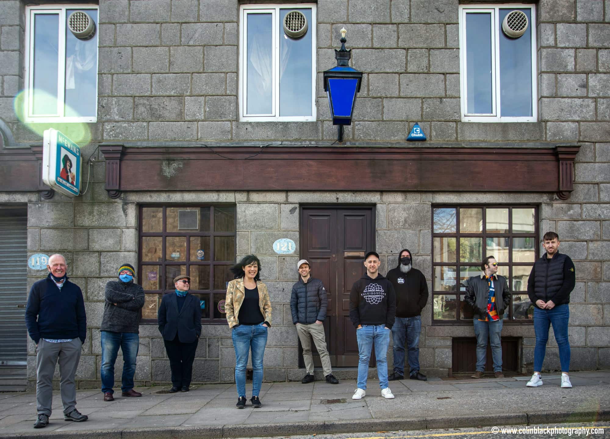 Aberdeen Jazz Festival crew standing outside of a venue smiling.
