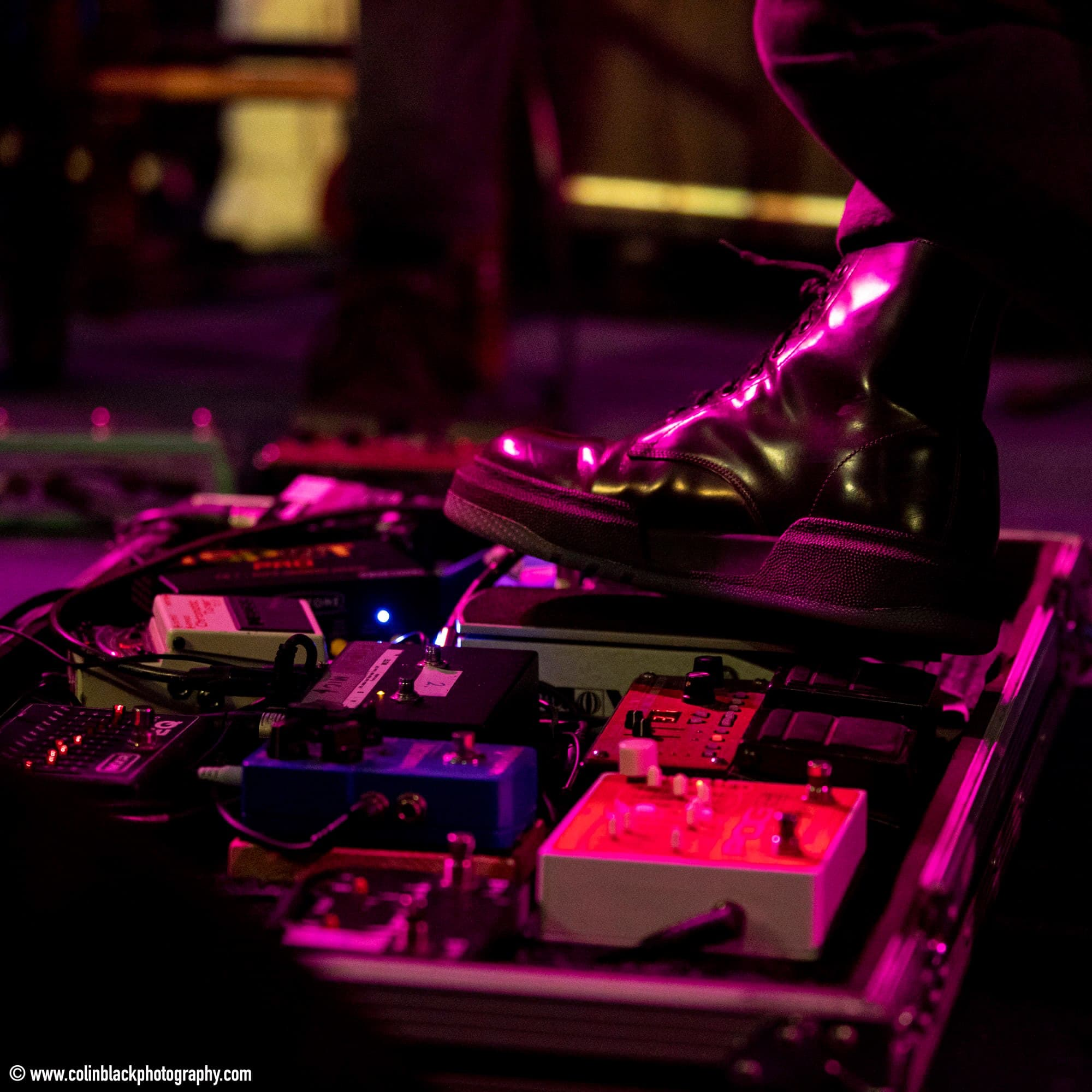 Black shoe operating pedal boards arranged on the ground