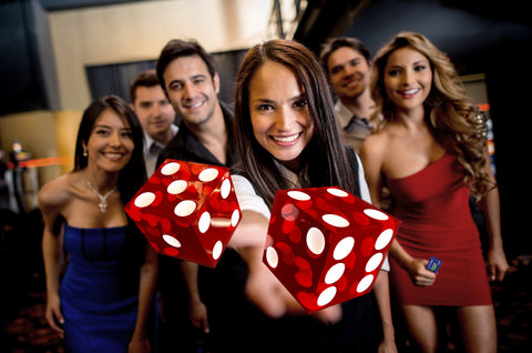group of guys and girls having fun with dice and a vegas bite card
