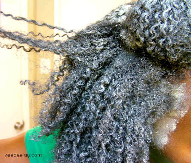Woman using bentonite clay mask for her hair