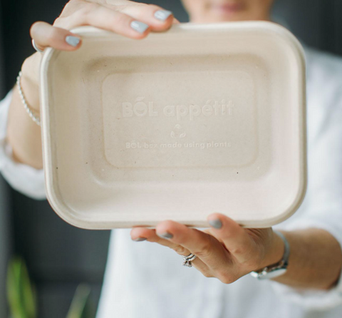 Woman holding a recycled dinner box