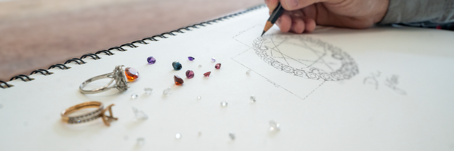 Site banner showing a custom ring design being sketched.