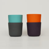 Small blue and orange bamboo wood eco friendly cups on Oates & Co.