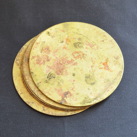 Recycled brass coasters from Africa on Oates & Co.
