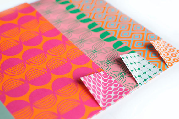 Brightly coloured luxury wrapping paper in pinks oranges and greens by Eva and Anne on Oates & Co.