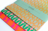 Orange, pink and green double sided wrapping paper by Eva and Anne on Oates & Co.
