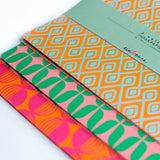 Colourful wrapping paper in graphic shape designs by Eva & Anne on Oates & Co.