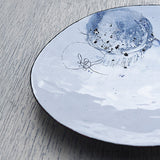 White and blue enamel plate handmade by Hayley Sutcliffe in Britain on Oates & Co.