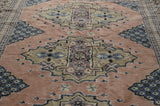 Vintage persian rug in light pink and grey colours and kazakh style on Oates & Co.