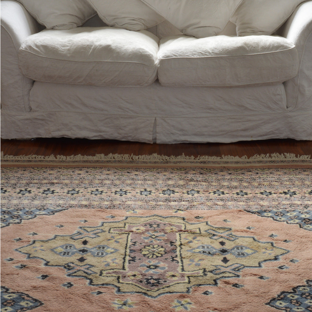 Large pink and grey muted tones vintage persian rug sourced in France on Oates & Co.