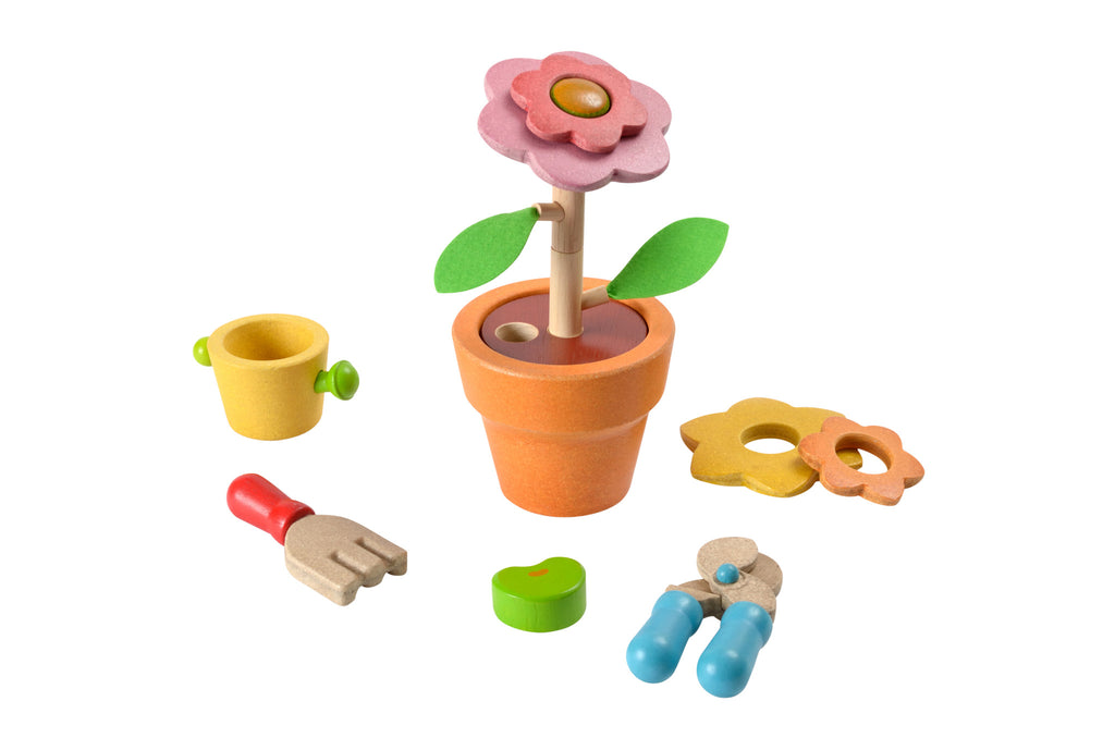 Wooden flower gardening set for pretend play by Plan Toys on Oates & Co.