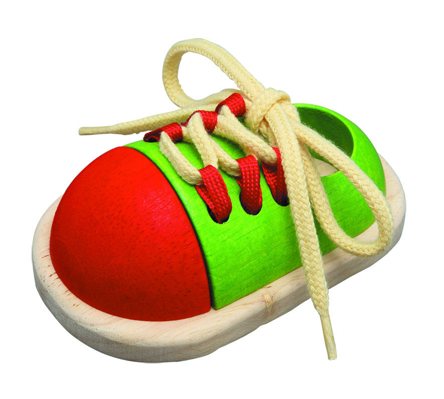 Tie up wooden play shoe to learn to tie shoelaces by Plan Toys on Oates & Co.