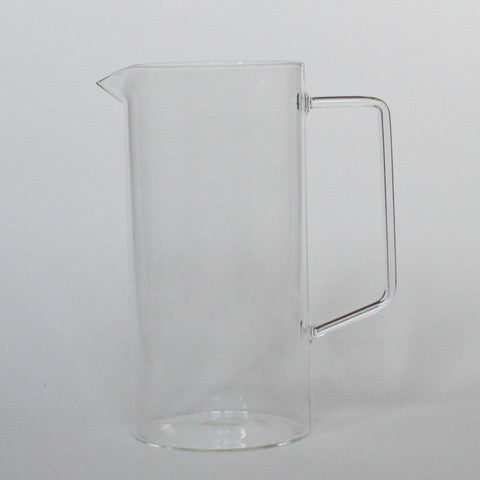 Simple medium sized glass jug with straight sides and delicate handle by Serax on Oates & Co.