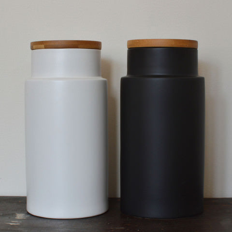 Large black and white ceramic kitchen storage jars by Serax on Oates & Co.