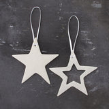 White porcelain christmas star decorations made in Britain by Brittany Delany on Oates & Co.