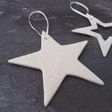 Delicate white porcelain star christmas decorations handmade by Brittany Delany on Oates & Co.