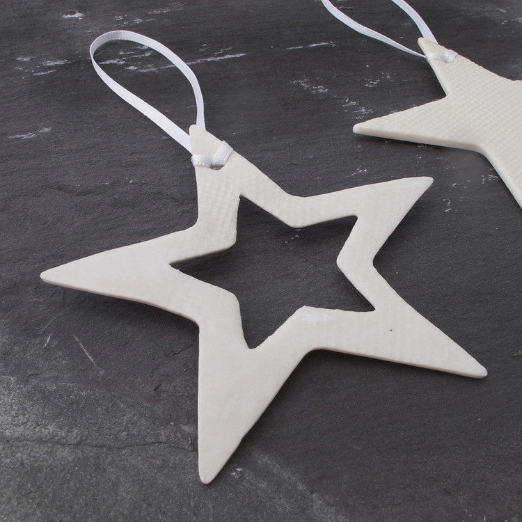 Delicate white porcelain star cut out Christmas decoration made in Britain on Oates & Co.