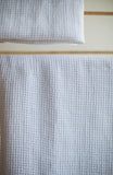 White linen waffle design hand towel by The Linen Works on Oates & Co.