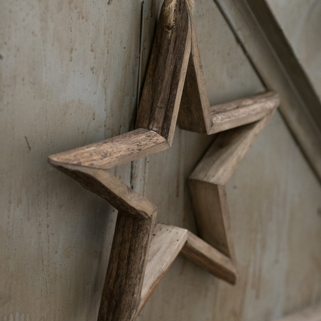 Wooden star wall hanging decoration by Tutti & Co. on Oates & Co.