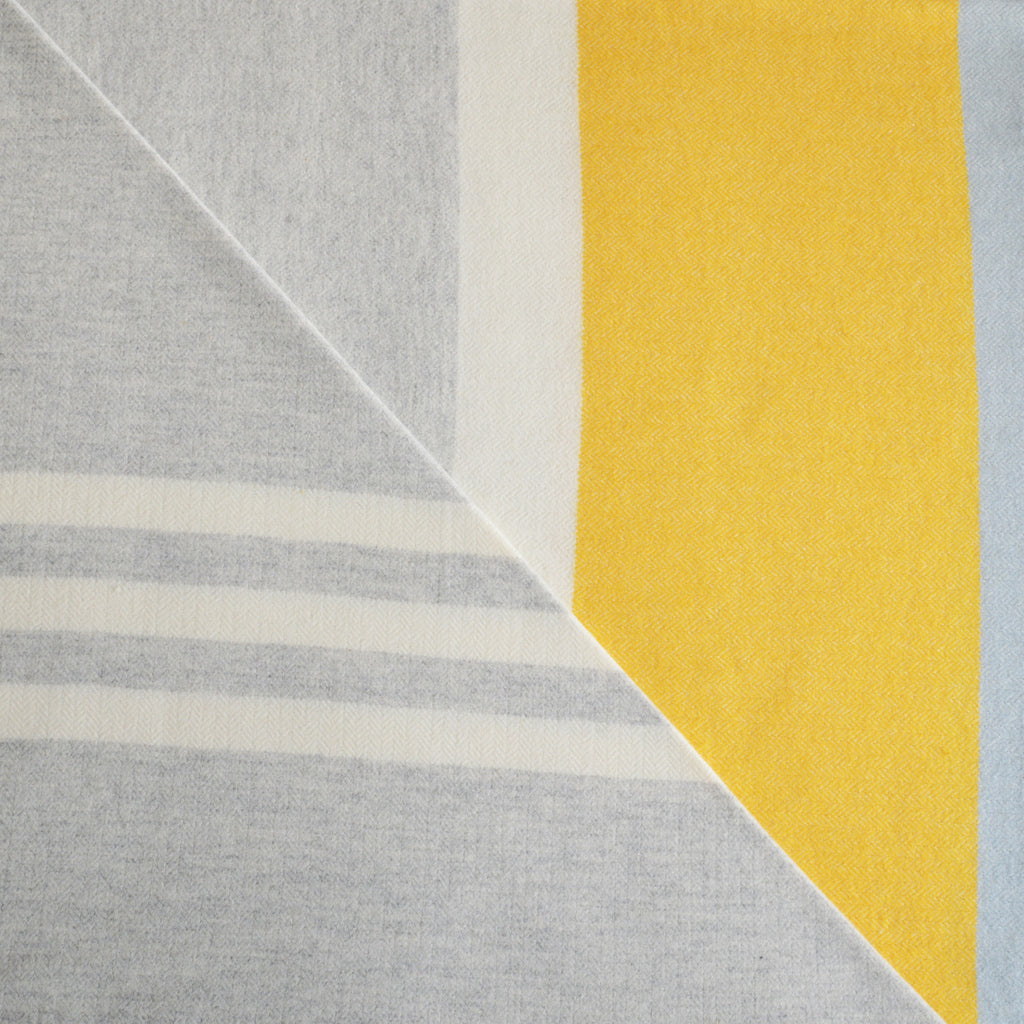 Grey and yellow stripe wool throw blanket in a herringbone weave by Twig on Oates & Co.