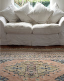 Large vintage persian rug in light pink and grey colourway on Oates & Co.