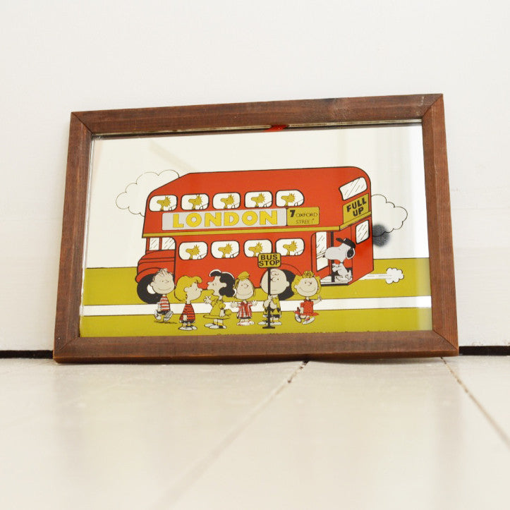 Vintage Snoopy print mirror with red London double decker bus on Oates & Co.