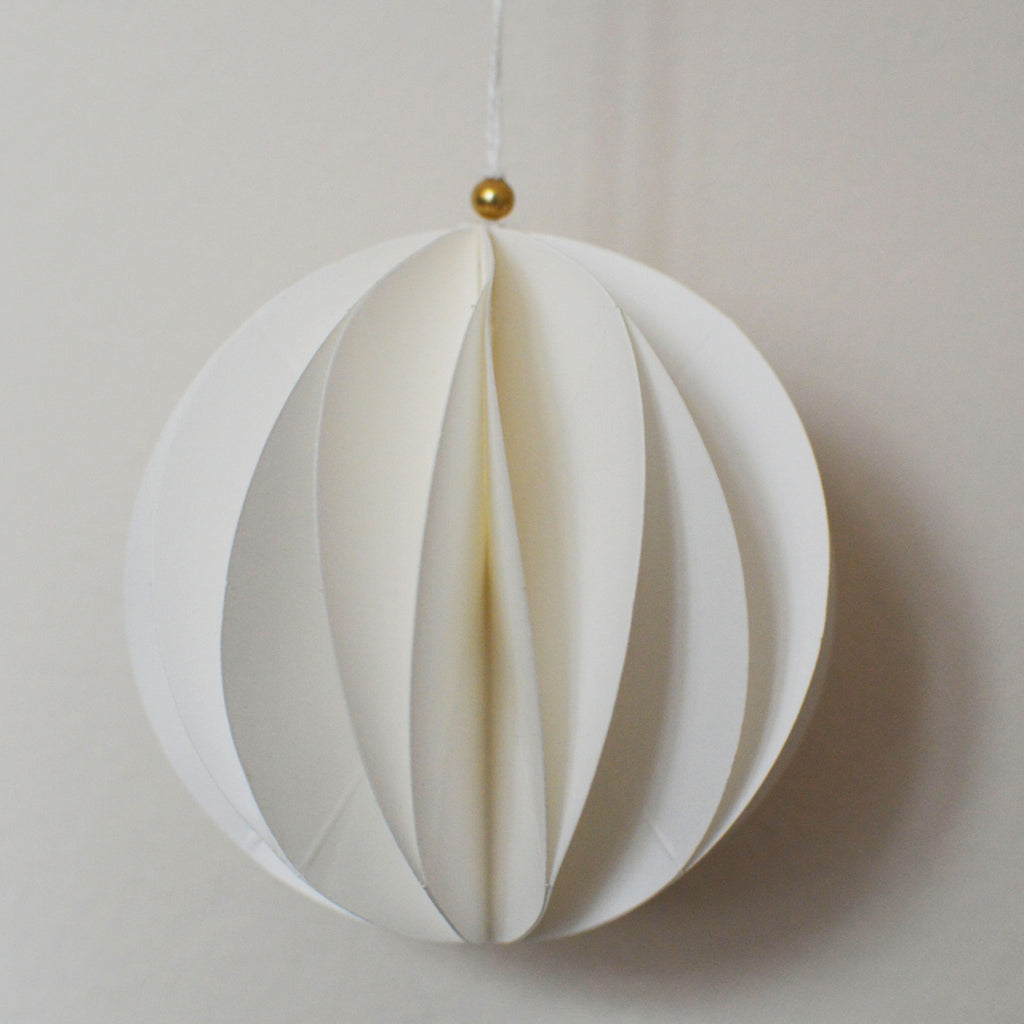 White paper ball christmas tree decorations in an origami style on Oates & Co.