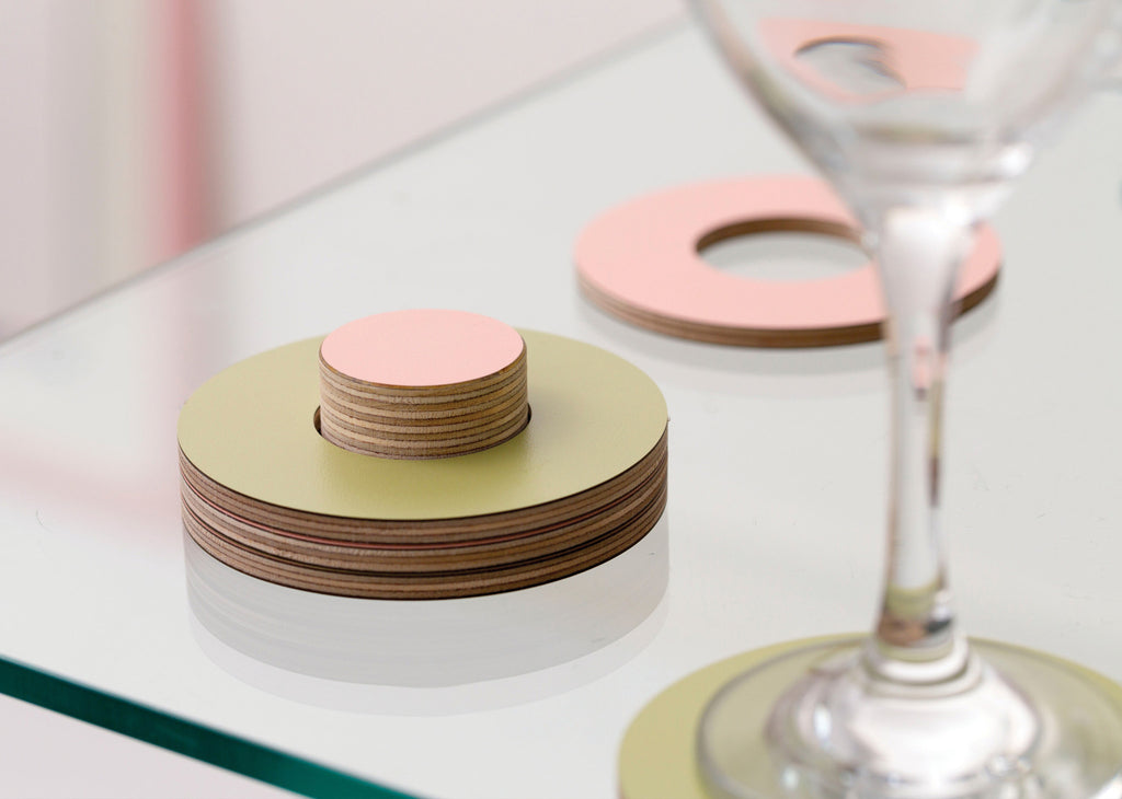 Coasters in green, pink and purple on a stackable ring by Block Design on Oates & Co.