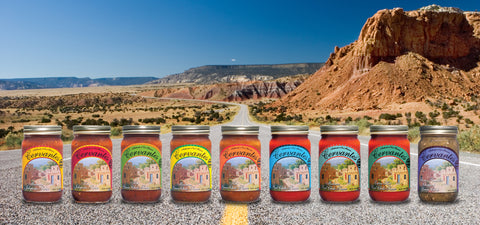 jars of cervantes salsa laid out on new mexico road with red tinted mesa in the background
