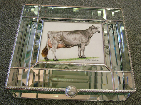 Stained glass box with cow portrait