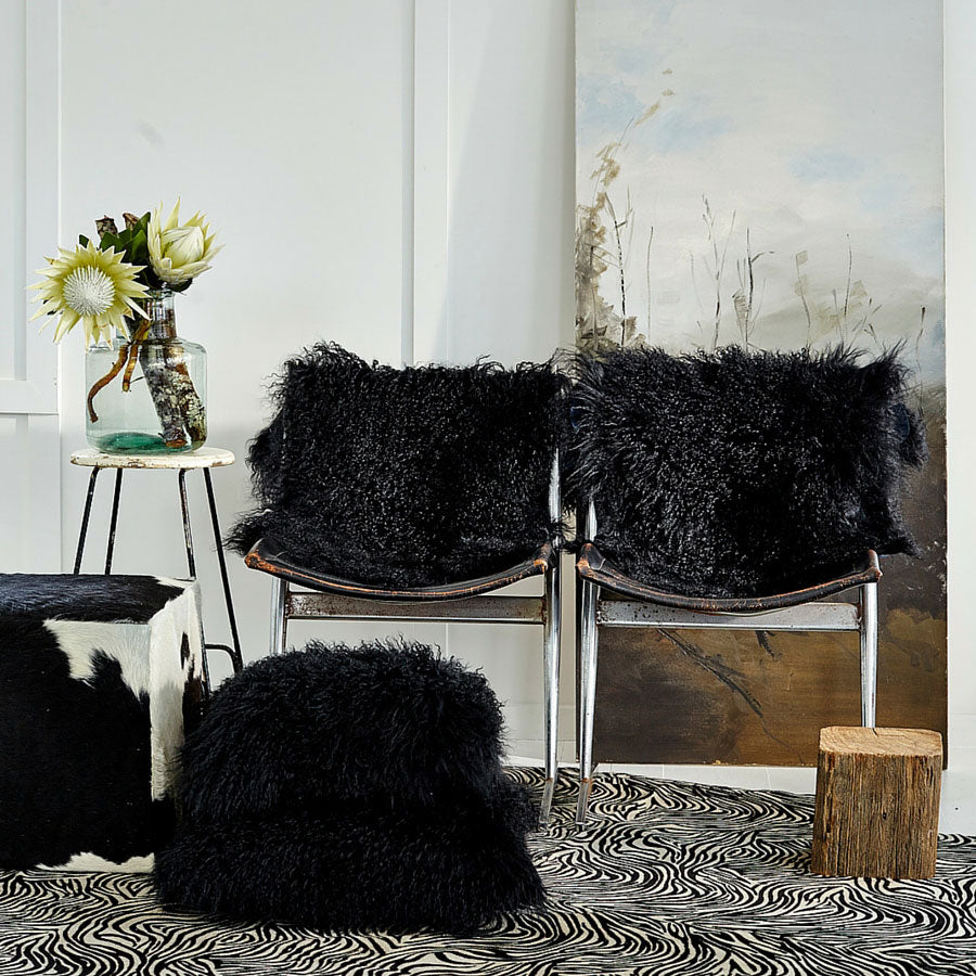 styled black Mongolian sheepskin rugs and cushions in black