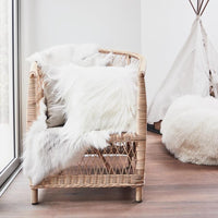 Long hair 60cm square Himalayan goatskin cushion in natural white styled on a chair